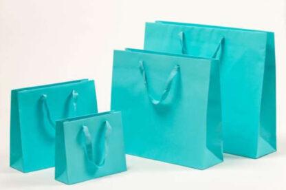 Exklusive Papiertragetasche Baumwollbänder glamourös hochwertig stabil Werbemittel Logodruck schnelle Lieferung günstig preiswert kompetent unterschiedliche Größenformate Türkis